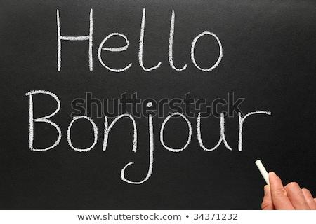 Stockfoto: Onjour · Hallo · In · het · Frans · Geschreven · op · een · schoolbord