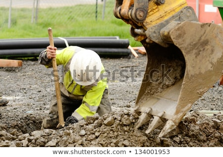 a male construction worker using a shovel stock photo © photography33