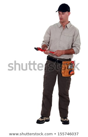 Amazed man holding a pipe wrench Stock photo © photography33