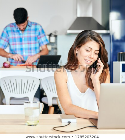 Couple following a recipe on a laptop Stock photo © photography33