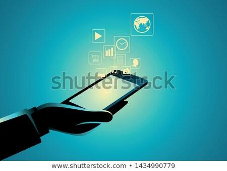 Multimedya palmiye el genç Internet Stok fotoğraf © silent47