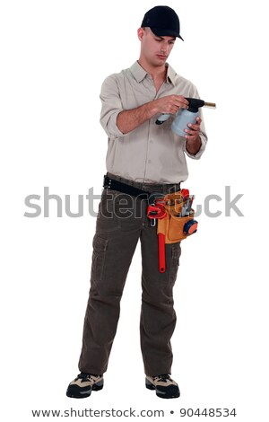 man reading blow torch instructions stock photo © photography33