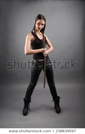 Girl lipstick looking at blade of sword Stock photo © pzaxe