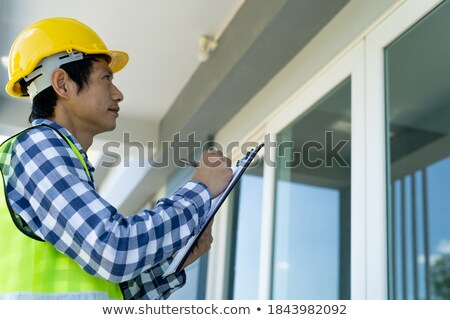 Engineer Taking Notes - Complete stock photo © lisafx