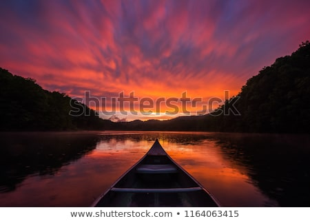 canoeing at dusk stock photo © ca2hill