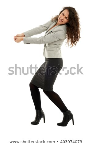 Businesswoman pulling an invisible object Stock photo © photography33