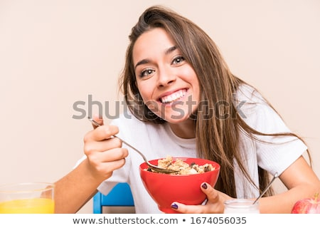 Girl eating cereal Stock photo © photography33
