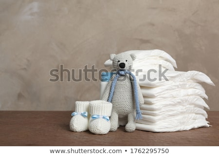stack of diaper with baby shoes Stock photo © pterwort