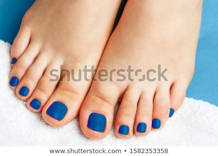 Female legs with blue toenails Stock photo © Nobilior