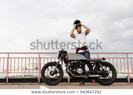 Guy taking off his helmet Stock photo © kalozzolak