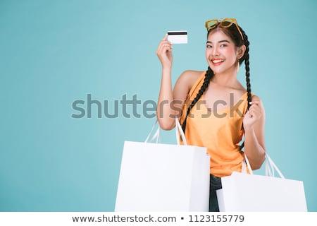 vrolijk · jonge · brunette · luisteren · naar · muziek · hoofdtelefoon · geïsoleerd - stockfoto © acidgrey
