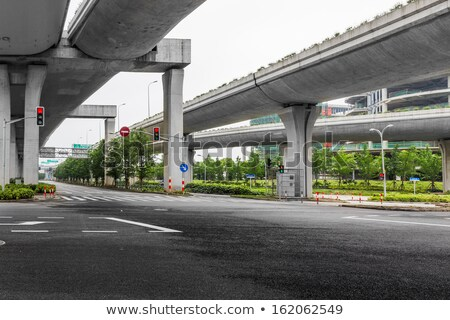 Low angle perspective view of a motorway road bridge Stock photo © lunamarina