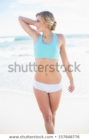 Blonde slim woman posing on the beach Stock photo © konradbak