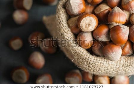 Hazelnuts on burlap background Stock photo © oly5