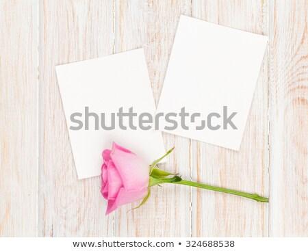two photo frames over wooden background stock photo © karandaev