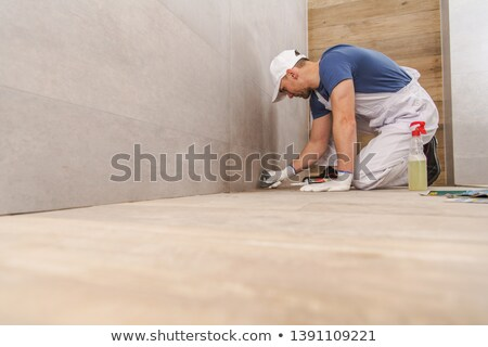 Worker grouts with silicone Stock photo © Kzenon