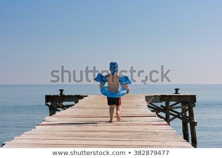 мальчика ходьбе пляж старые красивой пирс Сток-фото © meinzahn