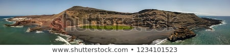 volcanic stone formation with blue sky at el golfo lanzarote stock photo © meinzahn