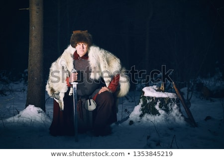 Stock photo: Medieval knight on his knee.