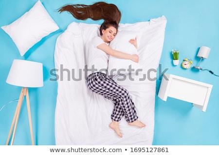 slapen · brunette · bed · kussen · home - stockfoto © trendsetterimages