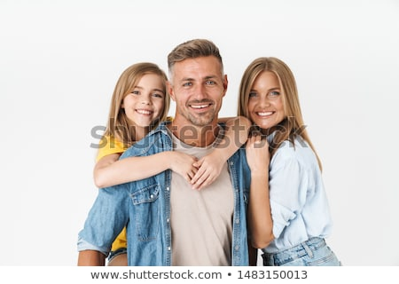 Blond woman carried by three handsome men Stock photo © konradbak