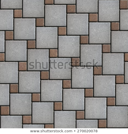 Gray-Brown Paving Slabs Laid Alternately Large and Small Squares. Stock photo © tashatuvango