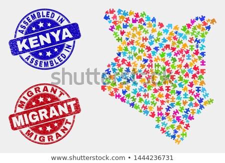 Migrants - Text on Red Puzzles.  Stock photo © tashatuvango