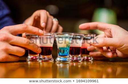 Shots with rum and liquor in cocktail club Stock photo © jordanrusev