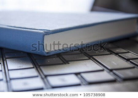 Stack of books with a connected black keyboard stock photo © Paha_L