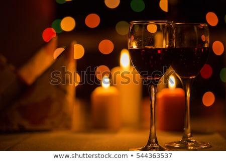 Piros gyertya fény fekete üveg fa Stock fotó © Photoline