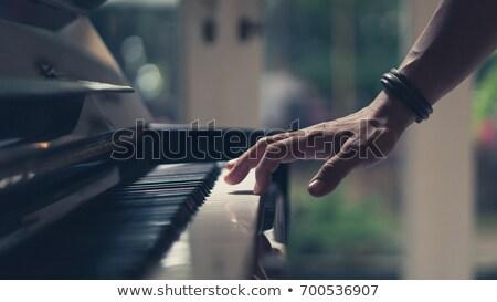 Male hands on piano keyboard Stock photo © zurijeta