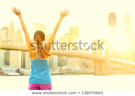 Siker nyerő boldog fitnessz nő karok a magasban felfelé Stock fotó © Maridav
