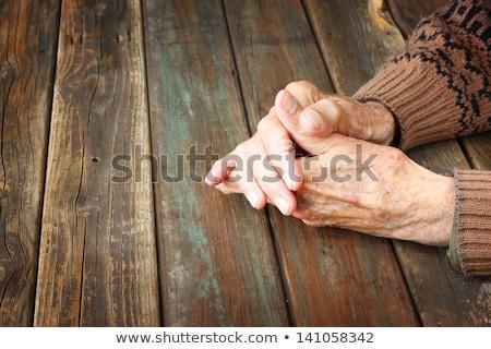 Manos anciano mesa espera Foto stock © Giulio_Fornasar