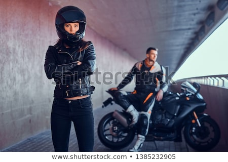 biker girl sitting on motorcycle stock photo © cookelma
