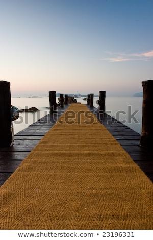 fából · készült · móló · vízpart · naplemente · napfény · eltűnik - stock fotó © capturelight