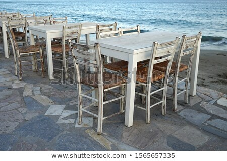 Old wooden chair near the sea - Crete, Greece stock photo © ankarb