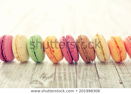 package with colored macaroons on a white wooden background stock photo © kotenko