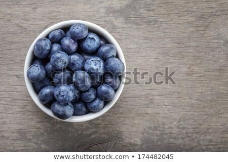 heap of fresh blueberries in white bowl stock photo © andreypopov