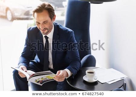 Portrait heureux homme lecture magazine restaurant Photo stock © wavebreak_media
