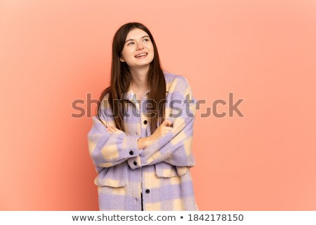 Beautiful brunette girl in pink smiling while looking up  Stock photo © julenochek