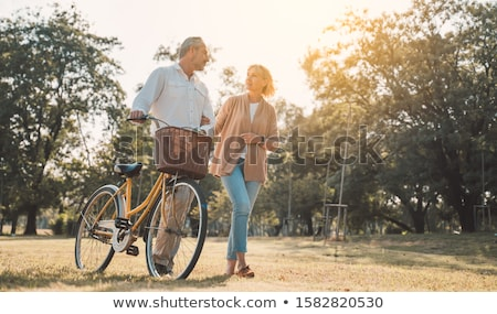 Couple walking with cycles Stock photo © IS2