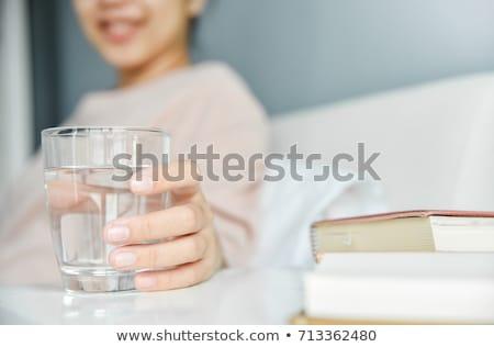 Női tart üveg víz nő szemüveg Stock fotó © IS2