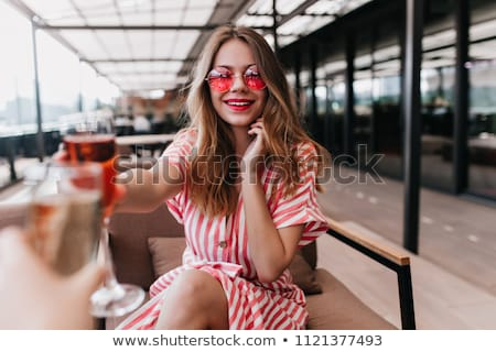 portrait of woman holding cocktail drink and looking to camera on white Stock photo © LightFieldStudios