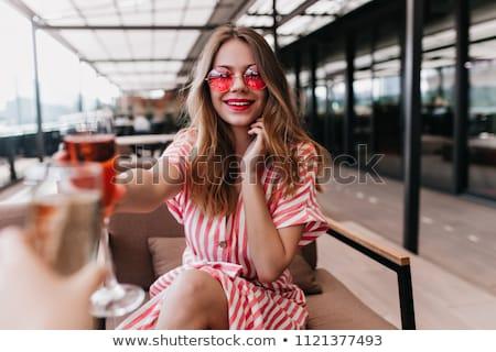 uśmiechnięta · kobieta · cocktail · party · napojów · wakacje · luksusowe - zdjęcia stock © lightfieldstudios