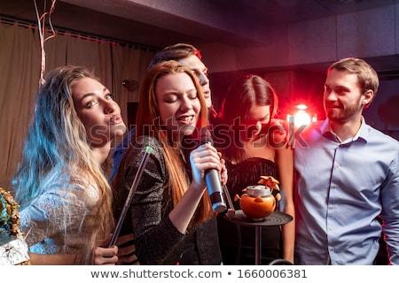 Karaoke śpiewu dziewczyna mikrofon twarz Zdjęcia stock © keeweeboy