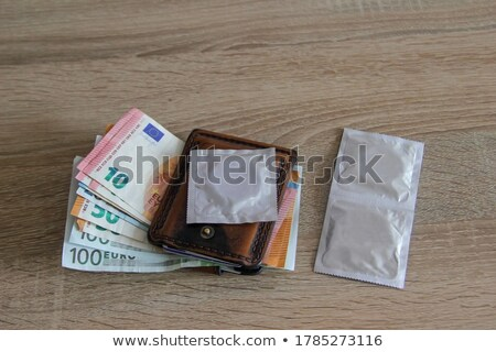 Condoms on wooden table  Stock photo © magraphics