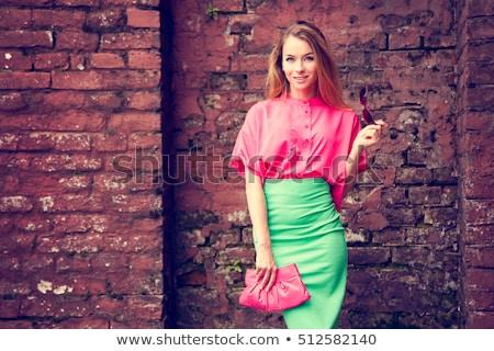 Mulher loira rosa blusa óculos de sol retrato atraente Foto stock © Traimak