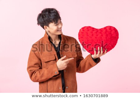 Yakışıklı adam kırmızı yastık resim adam mutlu Stok fotoğraf © dolgachov