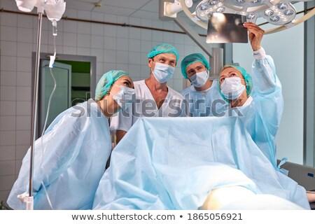 Pielęgniarki chirurgiczny rękawice xray pokój Zdjęcia stock © wavebreak_media