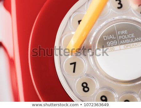 Close Up of Retro Telephone Dial with Pencil Stock photo © frannyanne